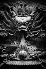 Facing A Dragon (kieronjameslong) Tags: portrait sculpture art statue temple chinatown dragon chinese folklore carving relief sarawak malaysia borneo mythology kuching chinesetemple chinesedragon chineseart highrelief