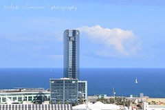 Wela (suominensde) Tags: barcelona sea espaa cloud seascape landscape hotel boat mar spain nikon cityscape outdoor horizon worldtradecenter arc catalonia cielo barceloneta catalunya nube catalua horizonte espanya wela hitecture d5300