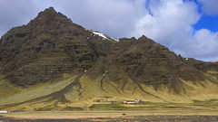 serious farming in a serious landscape :) (lunaryuna) Tags: sky panorama mountains nature beauty clouds season landscape coast iceland spring farm rockface textures geology lunaryuna vastness southeasticeland seasonalwonders