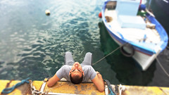 man... (Love me tender .**..*) Tags: blue sea people man blur water colors face yellow portraits greek photography boat greece 2016 megara pahi dimitrakirgiannaki kostaspolizos