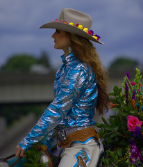 A Beautiful Profile (swong95765) Tags: flowers woman beautiful female bokeh longhair parade sideview rider equestrian