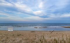 leaving shore (almostsummersky) Tags: ocean travel sea summer sky plant beach water grass clouds us sand waves unitedstates dunes tide horizon atlantic shore delaware atlanticocean tides bethanybeach