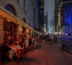 Dining on the streets of New York (Jeffrey Friedkin) Tags: street city nyc newyork architecture night buildings outdoors lights neon y manhattan streetscene timessquare cityscene newyorkscene
