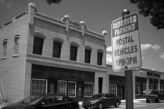 Reserved (Jlubs) Tags: fuji fujifilm xe1 filmsimulation blackandwhite bw monochrome mirrorless adaptedlens legacylens fd fdmount vivitar 28mm f28 42mmequivalent reservedparking streetphotography street photo candid cityscape oldnew bricktown oklahomacity oklahoma ok