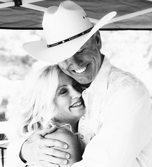 Deirdre and Chip (kylebagleyphotos) Tags: wedding photo portrait blackandwhite event photography sigma canon happy smiles candid cowboy hat t3i bright sun summer hug couple telephoto