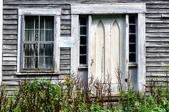 The past is gone (trochford) Tags: old empty abandoned weathered peeling sagging texture textured gray clapboard house home building structure door window curtain overgrown rural eastwashingtonnh washingtonnh nh newhampshire newengland usa canon outdoor exterior