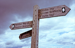 many ways to go (Ron Layters) Tags: sign post pennineway canhighroad sky yorkshiredales day10 england unitedkingdom slidefilmthenscanned slide transparency fujichrome velvia canoneos300v canon eos300v rebelti ronlayters