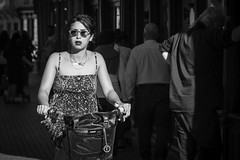The sunny girl... (Periades) Tags: bw blackandwhite blackwhite bicycle bike bijou candid cycling fille femme fashion girl glasses human jewel lunettes mode noiretblanc nb contrast photoderue rue streetphotography street streethuman vlo woman