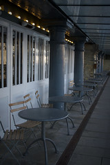 Cafe in Shad Thames (Roving-Aye!) Tags: uk blue england cafe britain pillar perspective tables boardwalk pillars roundtable southwark shadthames glassceiling emptytables 2014 whitedoor outdoorcafe emptychairs frenchdoor whitewindows sigma1770mm vacantchairs canon7d bluepillar vacanttable