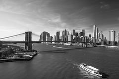 Lower Manhattan and Brooklyn Bridge from Manhattan Bridge, New York City (LeeHoward) Tags: city nyc bridge blackandwhite newyork ferry skyline river boat manhattan brooklynbridge manhattanbridge eastriver bigapple lowermanhattan freedomtower 1wtc