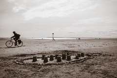 On Yer Bike (NVOXVII) Tags: uk blackandwhite beach monochrome bike bicycle silhouette sussex coast spring nikon cyclist waterfront 1855mm seafront sandcastles sandcastle bnw dlsr d3200