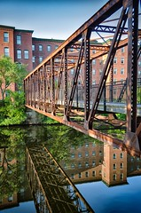 Pedestrian Walkway (jpr_me) Tags: mill pedestrianwalkway bridge nashua nashuariver newhampshire summer reflection blindphotographer millbuilding nashuamanufacturingcompany water outdoors d7000 1855mmf3556gii nikon convergence nature fineartphotography clocktowerapartments