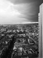 Frankfurt in thunder and rain (nk_jan) Tags: frankfurtmain germany bronicarf645 zenzanonrf45 fomapan400 hc110 blackandwhite schwarzweis schwarzweiss blackwhite mediumformat railwaymainstation silberturm silvertower thunder rain skyscraper clouds street kunstprivat