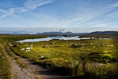 Connemara lake (Leo Bissett) Tags: wild lake mountains reflection galway stone landscape track lough calm connemara lane remote bog rossaveel oughterard