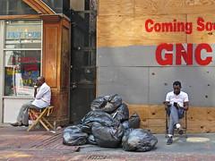 BostonManTrashMan (fotosqrrl) Tags: boston massachusetts streetphotography urban winterstreet trashbag chairs plywood