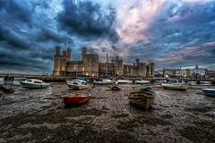 Caernarfon Castle at Dusk (karlmccarthy1969) Tags: castle caernarfon sky clouds boats wideangle water wales mud landscape