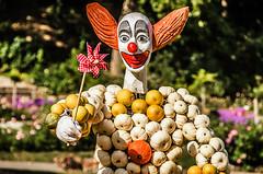 Pinwheel (Melissa Maples) Tags: ludwigsburg germany europe nikon d5100   nikkor afs 18200mm f3556g 18200mmf3556g vr residenzschloss palace blhendesbarock garden summer krbisausstellung pumpkins pumpkin festival sculpture art circus clown pinwheel