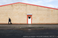 52-62 Brand St, Glasgow - Looking North (chirgy) Tags: door blue orange brick glasgow southside shape assignment3 baltz nowindows manwalking taop fujifilmx100s 2015exhibition