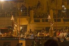 Ganga Aarati at Varanasi (Munisch) Tags: old travel light people sun india color history water birds night canon geotagged boats temple fire eos focus worship asia smoke palace human 7d varanasi tamron ganges ghats stillphotography aarati 18270mm