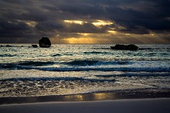 Sunlight through the clouds (JulyRiver) Tags: ocean sea sunlight nature water clouds sunrise reflections rocks wave cannon bermuda