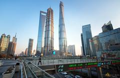 Crossing Over (Andy Brandl (PhotonMix.com)) Tags: china urban modern nikon cityscape skyscrapers shanghai financialdistrict business pudong jinmaotower pedestrianbridge lujiazui swfc shanghaitower photonmix
