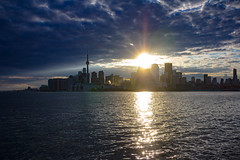 Sunset Over Toronto (A Great Capture) Tags: park city blue sunset urban cloud sun sunlight lake toronto ontario canada reflection water sunshine skyline clouds lights spring downtown photographer sundown dusk jennifer over canadian to lakeontario springtime on agc 2016 ald jamesmitchell kateryna ash2276 adjm jenniferkaterynakovalskyjpark ashleylduffus wwwagreatcapturecom agreatcapture mobilejay kovalskyj