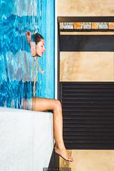 On the edge (Nicola Pezzoli) Tags: travel blue light summer sun water pool girl reflections island golden model king resort swimmingpool greece illusion edge luxury skiathos