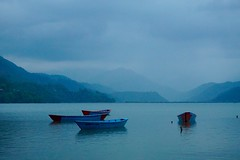 Blue boats at lake Fewa, before the last bit of daylight and the drizzle turned to rain! (PsJeremy) Tags: blue nepal boats explore lakefewa