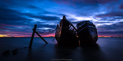 Eternity (grantg59@xtra.co.nz) Tags: ocean longexposure blue red sea sky seascape abandoned beach rotting beauty graveyard clouds sunrise landscape boats dawn boat ship decay forgotten eternity toil