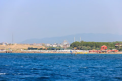 Side - beach view from the sea 2 (Romeodesign) Tags: sea summer holiday beach turkey coast mediterranean riviera sailing side urlaub trkiye shoreline mosque trkei antalya peninsula turkish 550d ferrriswheel pamphylian