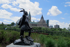 The Anishinabe Scout sculpture looking over the Ottawa River in Ottawa, Ontario (Ullysses) Tags: sculpture ontario canada spring ottawa firstnations printemps parliamentbuildings majorshillpark anishinabescout hamiltonthomascarltonplantagenetmaccarthy