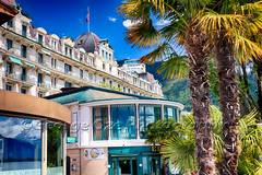 View of the Eden Palace Hotel, Montreux, Switzerland (George Oze) Tags: travel lake classic horizontal architecture landscape hotel switzerland colorful europe mediterranean bright swiss perspective scenic sunny historic palmtrees daytime relaxation quaint hospitality ch lakegeneva grandhotel montreux luxurious vaud grandeur palmettotree lowangleview buildingexteriors palatialhotel