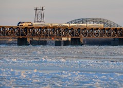 AMT 75 over a frozen river (Michael Berry Railfan) Tags: winter snow ice train quebec montreal lasalle stlawrenceriver commutertrain passengertrain emd gmd f59phi amt1322 amt75