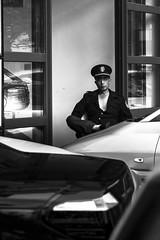 Parking Lot Attendent (banpreso) Tags: china street door white black glass car zeiss work benz uniform nap shanghai sleep sony parking lot police contax lazy cap petrol 35 job a7 sonnar vario 3570 attendent