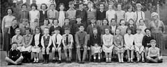 Class Photo (theirhistory) Tags: girls england boys socks children shoes uniform dress skirt teacher jacket shorts wellies pullover pupils wellingtons primaryschool juniorschool ocks