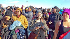Polar Plunge onlookers (TheeErin) Tags: bear new winter people newyork cold brooklyn club coneyisland island expression year crowd watching shoreline hats freezing atlantic shore triumph polar icy coney coats cinematic gawkers newyearsday plunge polarbearclub 2015