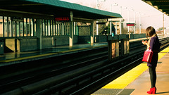 Waiting (Shira Bezalel) Tags: oakland waiting phone bart trainstation waitingforthetrain westoaklandbart womanwithphone
