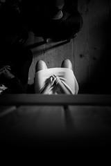 Waiting for the Moment (bernobserver) Tags: light bw woman black person hands sitting fuji shadows legs documentary rail human fujifilm bnw f20 x100 blacknwithe 23mm x100s