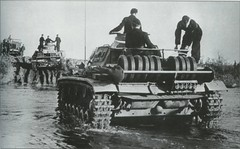 Panzerkampfwagen iii crossing a stream with Lots of extra road wheels.