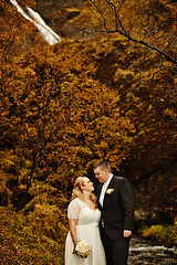 Alds & Sigurlaugur (LalliSig) Tags: autumn wedding portrait people orange woman brown white man black water yellow waterfall iceland colours photographer south east portraiture kirkjubjarklaustur systrafoss
