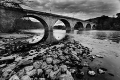 Telfords Bridge over the Tay at Dunkeld B&W (Daniel Giza) Tags: bridge blackandwhite reflection water monochrome canon scotland outdoor perthshire sigma tay dunkeld 1020 telfords 50d