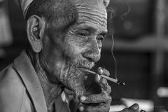 Doing it the old way (Nij Salam) Tags: old man cigarette traditional malaysia wrinkles terengganu