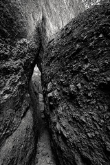 the sweetest condition (Super G) Tags: blackandwhite bw sculpture abstract rock stone exploring entrance climbing cave spelunking nikon278