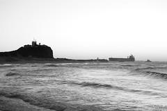0D6A1204 - Newcastle Cliche' Sunrise (Stephen Baldwin Photography) Tags: ocean light sea blackandwhite house beach water monochrome sunrise newcastle dawn sand ship australia nsw tugs cliche nobbys
