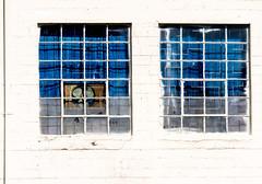 Blue Windows (johnemount) Tags: industrial buidling architecture windows blue white whitewash infrastructure fan windowfan rust brick cinderblock concrete
