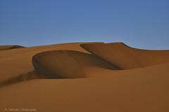 Red & Blue (Paterdimakis) Tags: sand dune qatar shadow shape line red blue sky nature landscape fuji curves