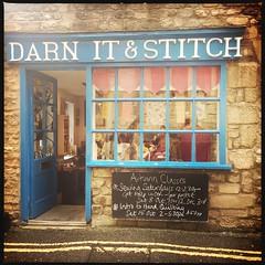 Darn It & Stitch (breakbeat) Tags: hipstamatic oxford instameet instagrammeetup photowalk city hipstamaticapp darnitandstitch sewingshop knitting yarn haberdashery text signage storefront door