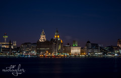 A View From Over The Water (Nic Taylor Photography) Tags: city liverpool cityscape sony sigma liverbird pierhead albertdock wallasey wirral a77 merseyside thethreegraces royalliverbuilding weddingphotographer portraitphotographer rivermersey sigma70200mmf28 sonyalpha eventsphotographer sonya77 photographermerseyside sonyslta77 photographersthelens portraitphotographersthelens