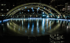 after the Zamboni finishes (mcfcrandall) Tags: christmas city winter urban toronto cold ice water reflections lights downtown december glow cityhall skating rink nathanphillipssquare