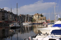 The Vieux Bassin (oxfordblues84) Tags: blue sky france reflection building water architecture clouds buildings reflections boats europe sightseeing bluesky honfleur normandy vieuxport pleasureboats lowernormandy roadscholar honfleurharbour honfleurharbor roadscholartour thevieuxbassin